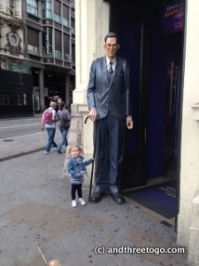 "Zoë with (a statue of) the tallest man in the world, in front of the ""Ripleys Believe It Or Not"" Museum in PIcadilly Circus"