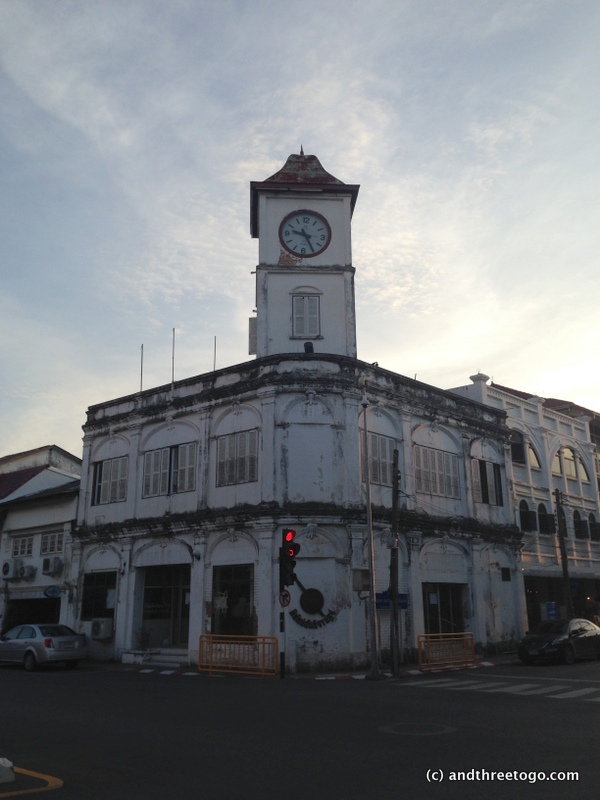 The clock tower in Phuket Town is stuck on 9:25.